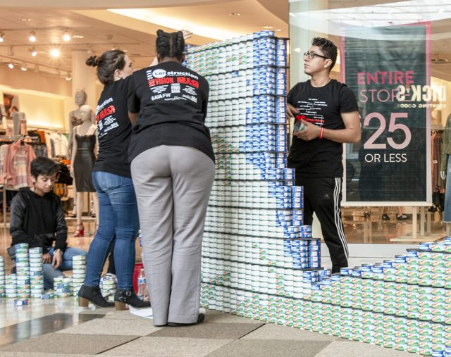 South students put the finishing touches on their can art at Canstruction.