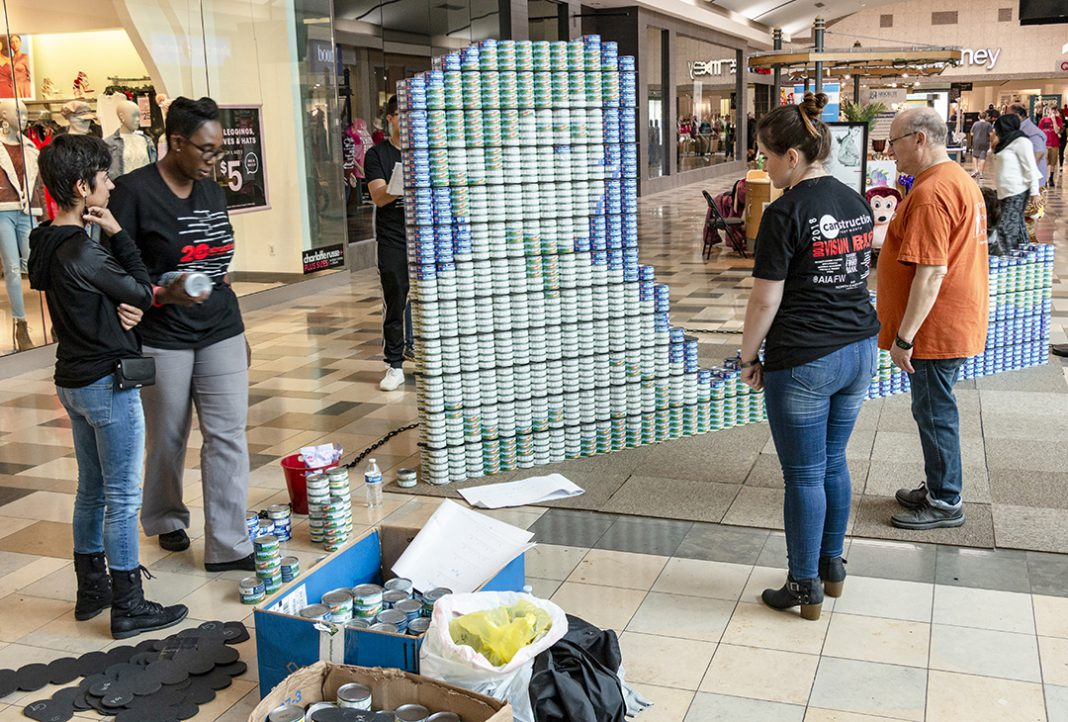 South architectural technology students use canned goods to make art in North East Mall in Hurst during Canstruction on Oct. 14. The cans were donated at the end of the event.