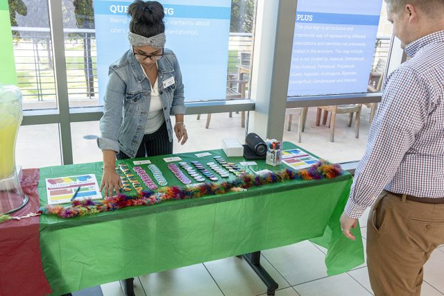 TR student development coordinator Angelica Cuellar sets up a table in preparation to hand out goodies and information during the event Oct. 11 on TR.