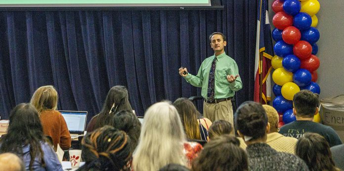 Derek Schreihofer, UNT Health Science Center pharmacology and neuroscience associate professor, speaks to students about medical research Sept. 26 in the TR Energy Auditorium.