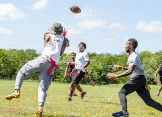 SE student Antonio Wauer throws a long pass as his teammates, SE students Jose Decruise and Nick Nunnally, look on during SE intramural flag football Oct. 4.