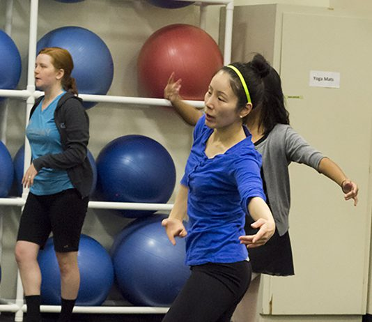 NE dance program coordinator Kihyoung Choi works with students during a class.