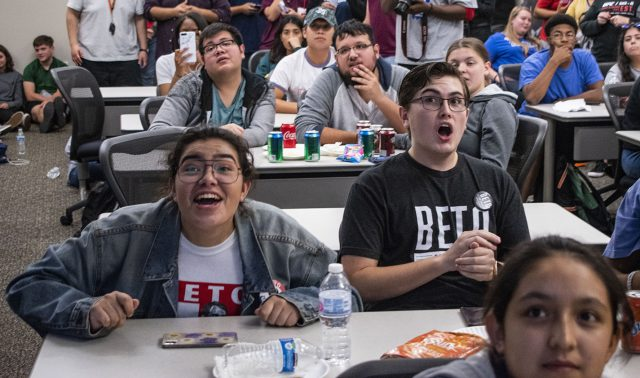 SE Organization of Latin America Club members react to polling data regarding the close U.S. Senate race involving Ted Cruz and Beto O'Rourke at the watch party.