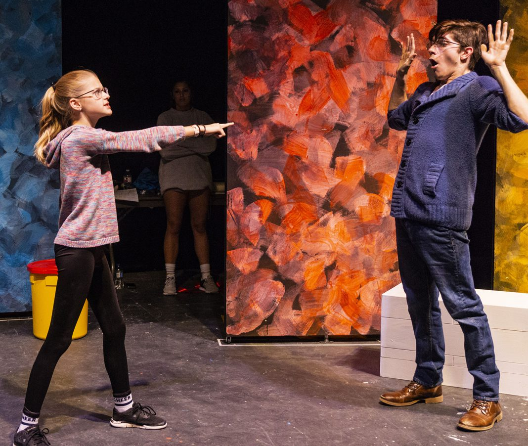 Westlake Academy 7th grader Megan Flight, who plays Benjamin, playfully interacts with NW student Lane Norris, who plays Benjamin's father, in The Yellow Boat which comes to stage Nov. 14-18 in Theatre Northwest.