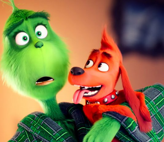 The Grinch's titular character holds his dog Max in a state of bewilderment at the endless holiday cheer from Whoville's residents. The movie was released in theaters Nov. 9.