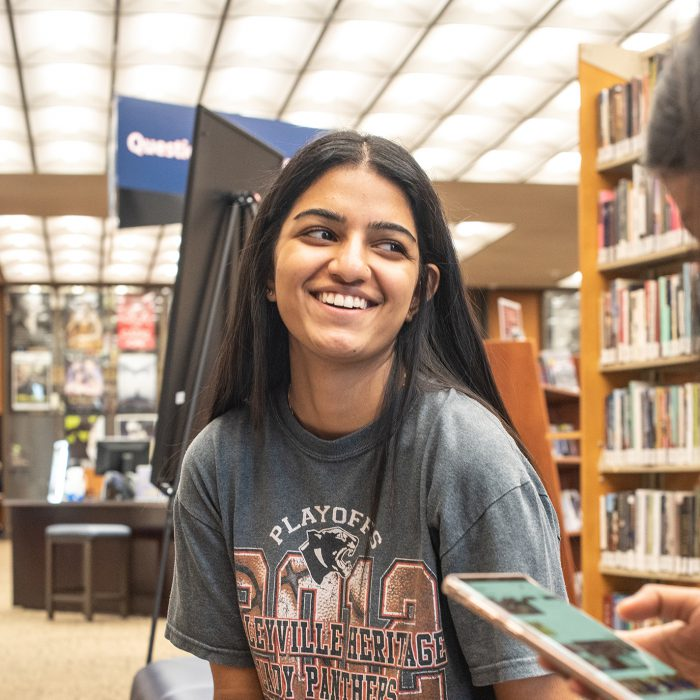 NE student Regal Sethi sits in the library and discusses her schedule with her classmates. Joseph Serrata/The Collegian