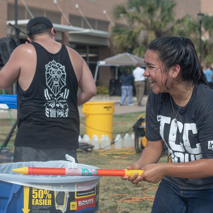 SE students enjoy a variety of activities including water gun fights during Big Splash II, a back to school celebration on SE Campus sponsored by student activities. Photo by Joseph Serrata