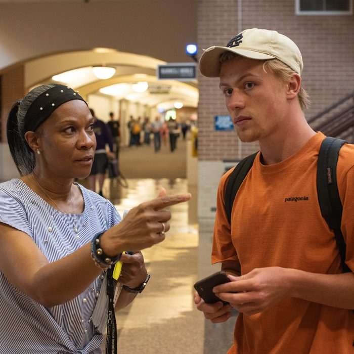 Mona Robinson, a senior office assistant with SE student activities, points SE student Rock Gorman toward his class on the first day of the school year Aug. 19. See page 8 for more back-to-school photos. Joseph Serrata/The Collegian