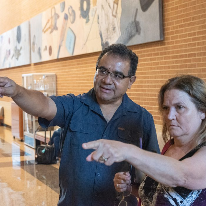 SE student Sherry Howard is given directions on where to go by dean of SE humanities Josue Muñoz. Tables lined the halls with snacks, water and campus experts giving directions on where to go during the first week. Joseph Serrata/The Collegian