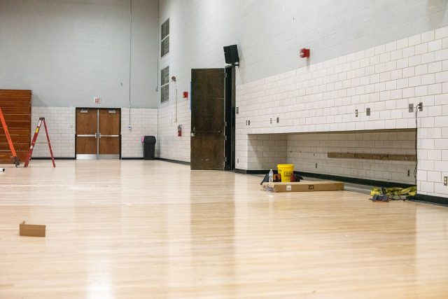 The gym floor is being resurfaced and treated for the water damage . The treatment process is performed in stages. Photo by Joseph Serrata/The Collegian