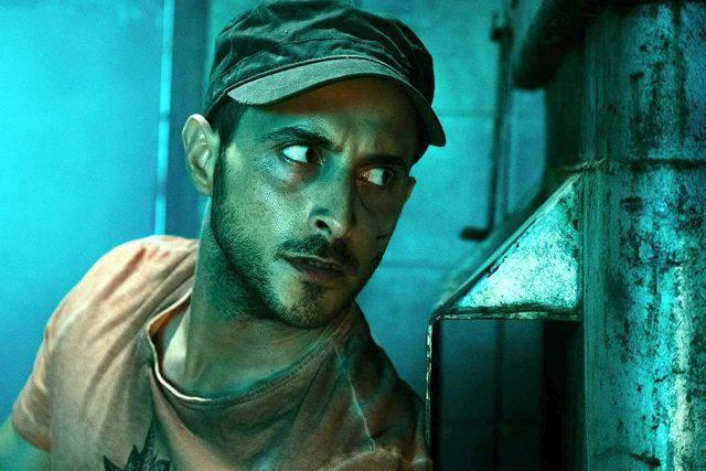 """One group member of """"The Boys,"""" Frenchie, played by Tomer Kapon, hides behind a dumpster while he eavesdrops. Courtesy Amazon Studios/Photos by Jan Thijs"""