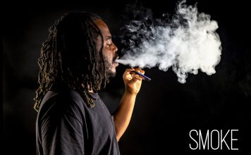 NE student Darian Chandler showcases his vaping technique as he exhales a cloud of nicotine-infused smoke. The CDC has linked six deaths to electronic cigarettes. Photo by Johnathan Johnson/The Collegian