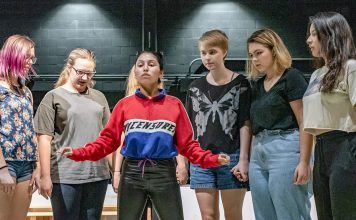 """Student performers with the NE Campus theater program practice choreography and rehearse their lines on stage for """"The Crucible."""" The 1953 Arthur Miller play is based on the Salem witch trials. Photo by Joseph Serrata/The Collegian"""