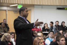 An audience member speaks to U.S. Reps. Marc Veasey of Texas, Eric Swalwell of California and Ruben Gallego of Arizona, who came to South Campus to talk with students about higher education and other concerns.