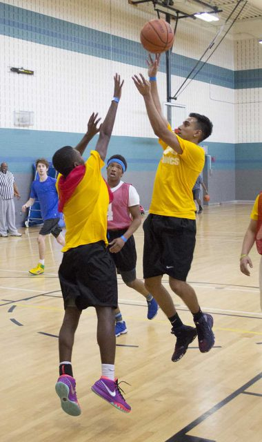 Michael Barnes tries to stop Aman Niak from getting the ball in the hoop during one of three intramural games on SE Campus.