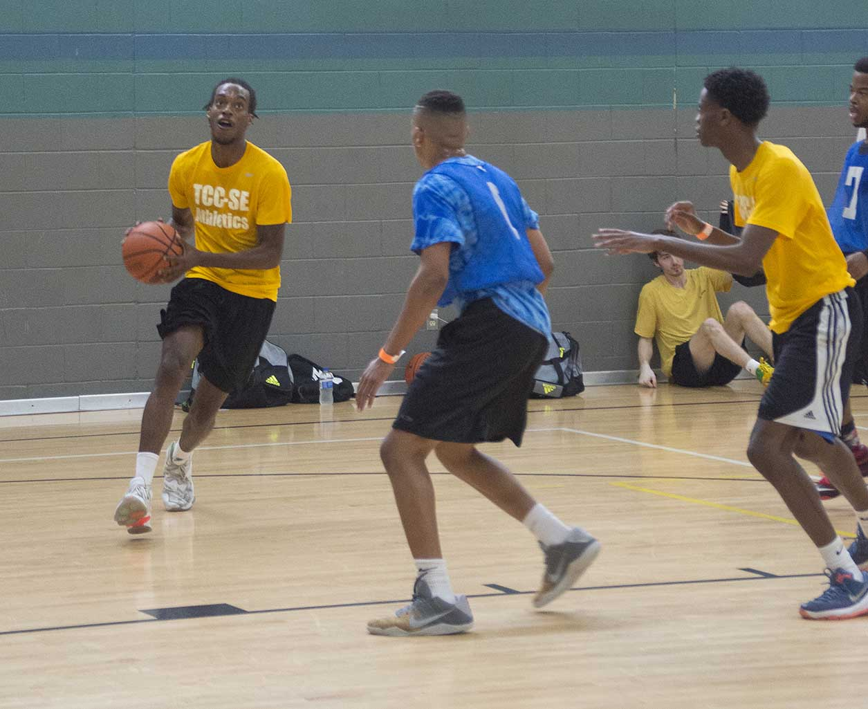 """Zach Thomas drives for the basket during one of the three games in the SE tournament. """"I knew we were going to win all along,"""" Thomas said."""