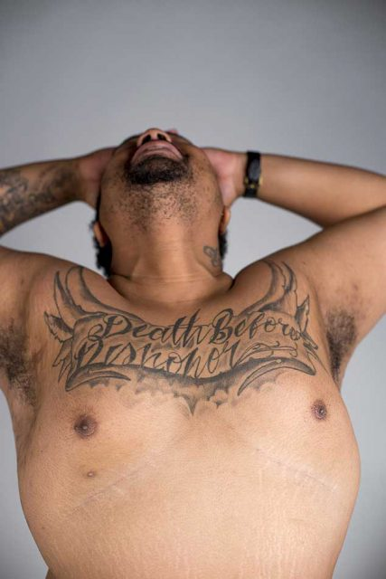 """Foster reveals his chest piece that reads """"Death Before Dishonor,"""" which he says has gang affiliation, but for him it's about how he'd rather die than dishonor God."""