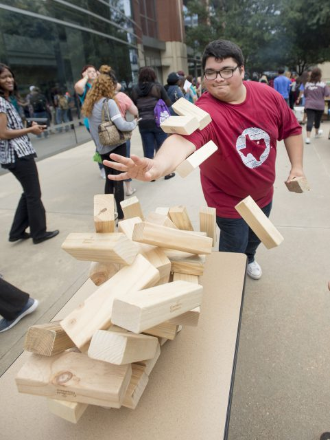TR student Adrian Vasquez tries to stop blocks from falling during a game of Jenga.