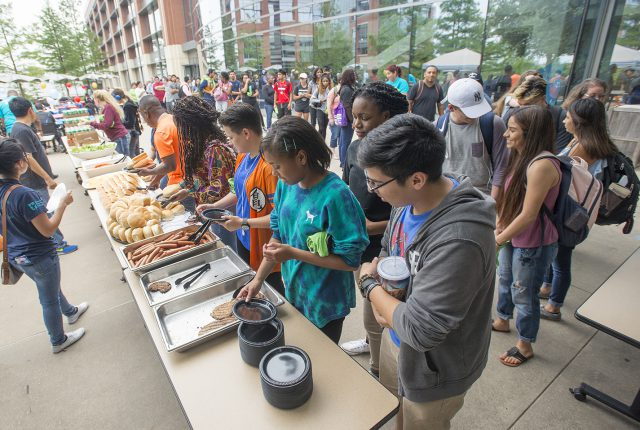 TR students rush the tables for free hot dogs and burgers at the TR Welcome Back Cookout Aug. 28. It was the first event to welcome students to the campus this semester.
