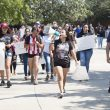 """South students march through campus chanting """"Who are we? DACA. What do we want? Support"""" on Sept. 14."""
