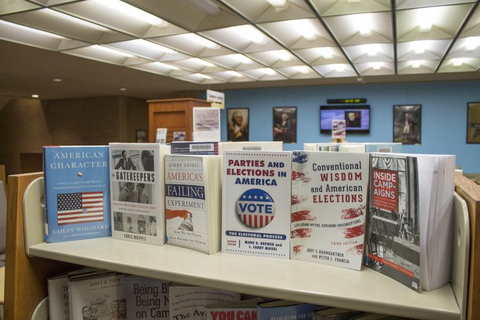 "The ""We the People..."" Constitution Day exhibit's book display highlights materials from the NE library's collection. Visitors can read about the Founding Fathers and enjoy various art and memorabilia from early American history."