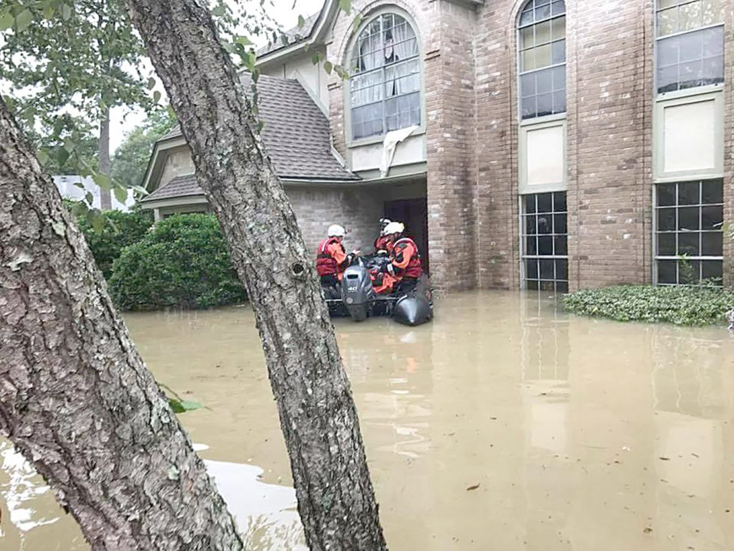 NW special operations adjunct instructor Bill VerSteeg checks on houses with other members of Texas Task Force 2. The team has helped local stations answer 911 calls.