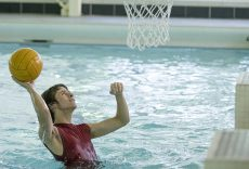 AJ Harrel, a student at SO and SE campuses, throws a ball into a basket during SO campus' Howdy Week: Intramurals Pool Party on Aug. 31.