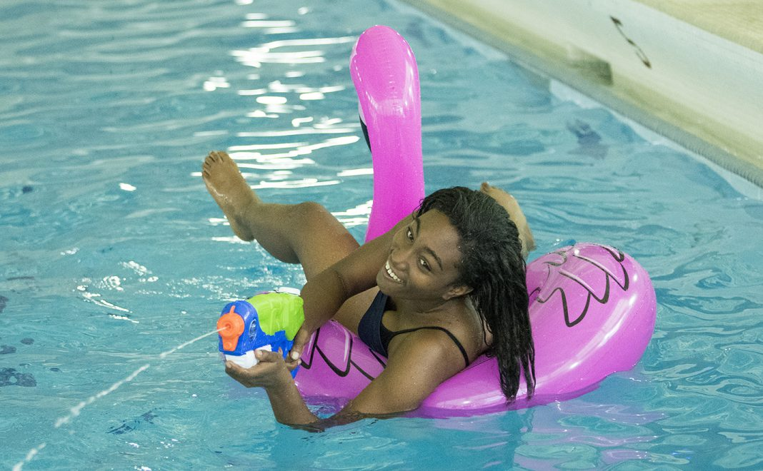 Chonte Turner uses a water gun to soak students during the Intramural Pool Party Aug. 31 on South Campus.