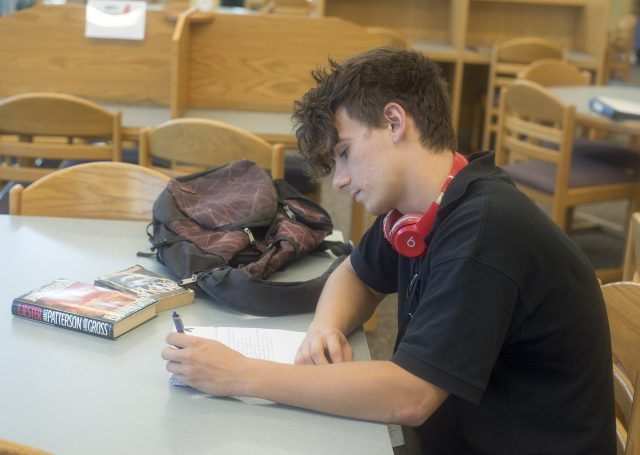 SE student Drew Cook studies in the SE library. Cook uses physical activity to manage his anxiety and depression.
