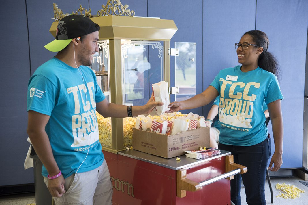 NW student Daniel Sanchez picks up popcorn from student activities team member Devin Reaux during Northwest Fest, a back-to-school event for NW students Sept. 7.