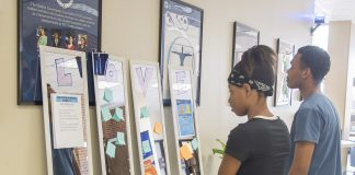 Keundrea Gunnell and Charles Mitchel look at the messages left by students on Sept. 11.