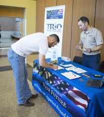 SE student Matt Russell, a U.S. Navy veteran, signs up for information about the TRIO program that offers educational outreach to University of Texas at Arlington's veterans.
