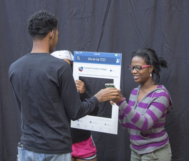 SE Campus' D.A.S.H.H. Prevention Squad kicked off It's On Us, a nationwide campaign to stop sexual violence. SE student Adedayo Odufowokan looks at a photo Banks took of her on her  phone at the event.