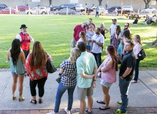 """Fort Worth Stockyards Ghost Tour guide Eugene """"Gene"""" Bonds talks about ghosts of the Livestock Exchange during a tour Oct. 14."""