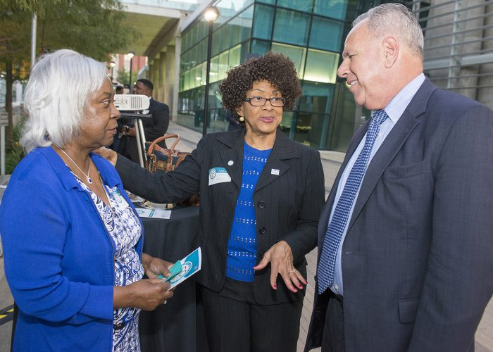 Chancellor Eugene Giovannini speaks with two former nursing students, Glenda Sturges (left) and Christine Moss (center), from the program's first class during the program's golden anniversary celebration Oct. 12 on TR East Campus.