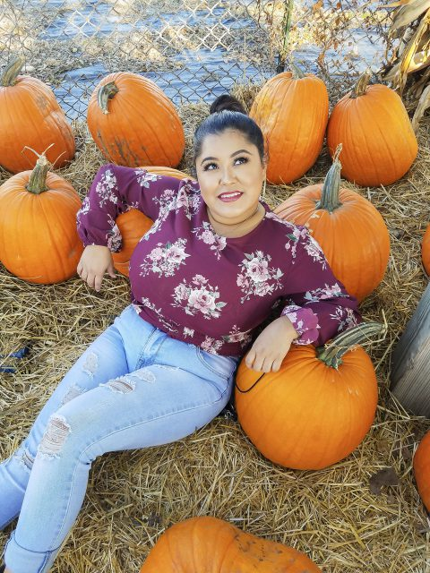 NW and TR student Jocelyn Romero poses for a photo with pumpkins Oct. 14.