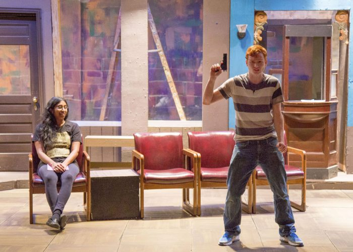 South students Hima Mettu and Christian West rehearse a scene from Passengers during a rehearsal Oct. 31. The cast consists of four actors who play 18 characters in eight scenes, all set in a Midwest bus station.