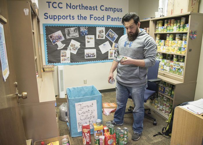 NE student worker Lance Lambert sorts and organizes donations at the NE food pantry. Lambert keeps track of the donations and stocks the shelves in NCAB 1136A.