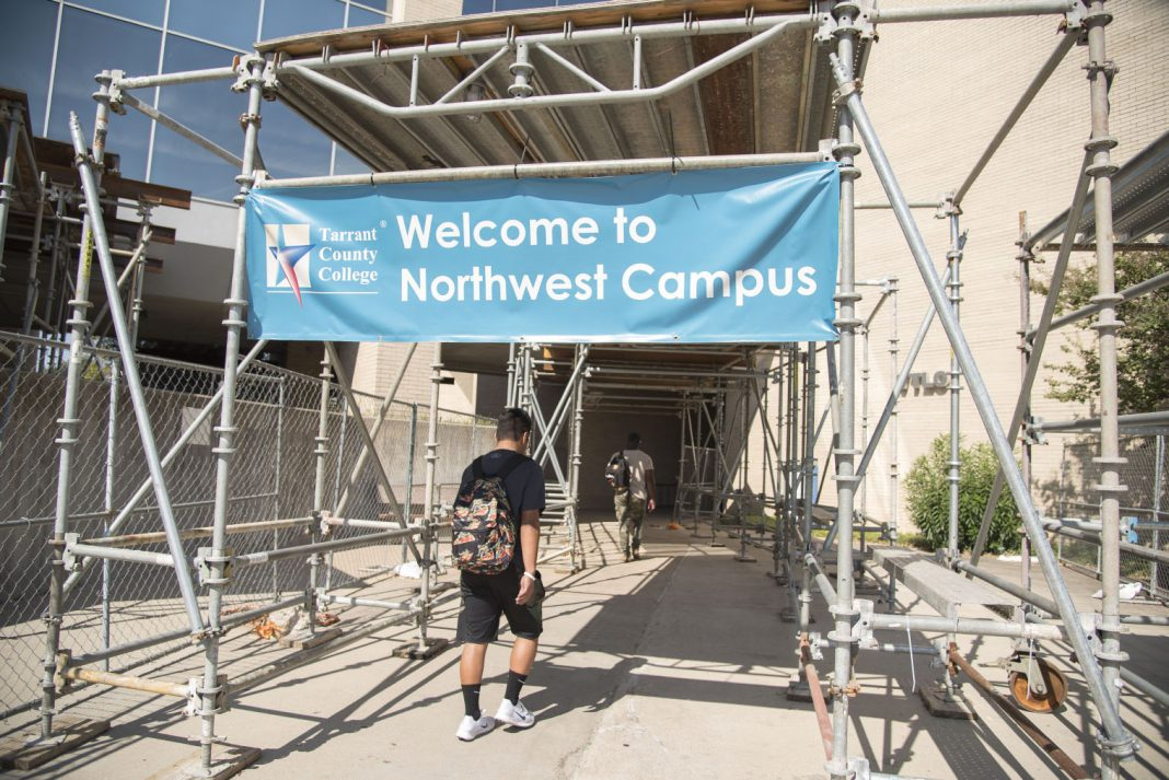 Students walk through a work zone at one of the main entrances near WTLO on NW Campus this fall. Scaffolding and fencing will remain standing for another year while engineers finish an assessment.