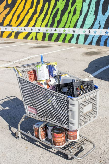 Vallarino used a shopping cart to store the paint, brushes and supplies at the market.