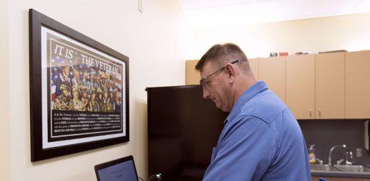 TR student Veterans Association president Donny Gore signs in to the Vet Success Center.