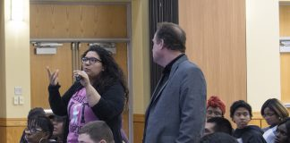 SE nursing student Brittney Candia stands with behavioral and social sciences chair Des Robinson and asks a question during speaker Lisa Wade's presentation Feb. 7.