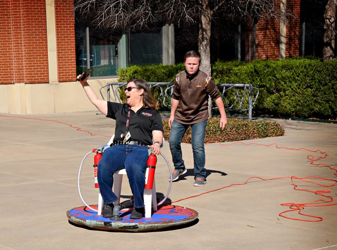 Last year's Fab Now Maker Conference attendees test out a hover chair. Students and small business developers will showcase experiments and creations.