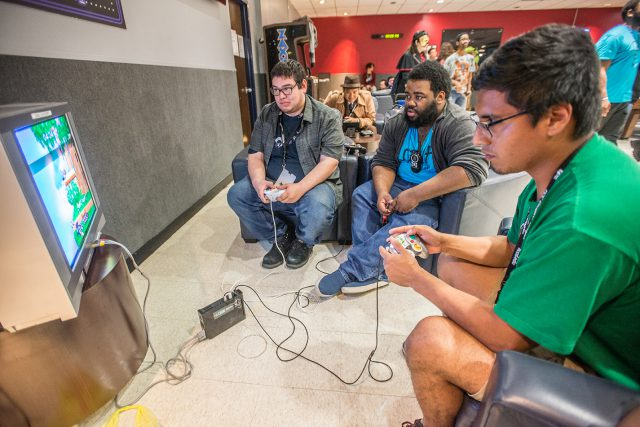 Eric Torres of Fort Worth plays Smash Bros. during a video game challenge at the South Campus Anime Convention April 14. Several video game tournaments were held.
