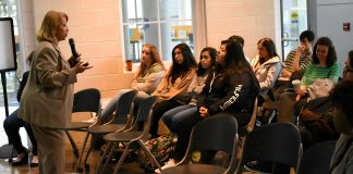 South Dallas Business and Professional Women's Club president June M. Johnson addresses a group of students on TR Campus March 28. The role of women as heroes in history and the importance of how women communicate with one another were at the forefront of Johnson's speech.