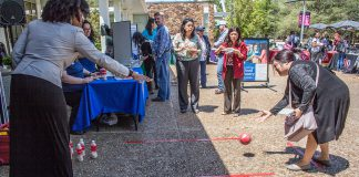 South Campus academic advisors cheer on students bowling at their booth during South's Spring Fest to celebrate Earth Day and kick off the Bioblitz project April 18.