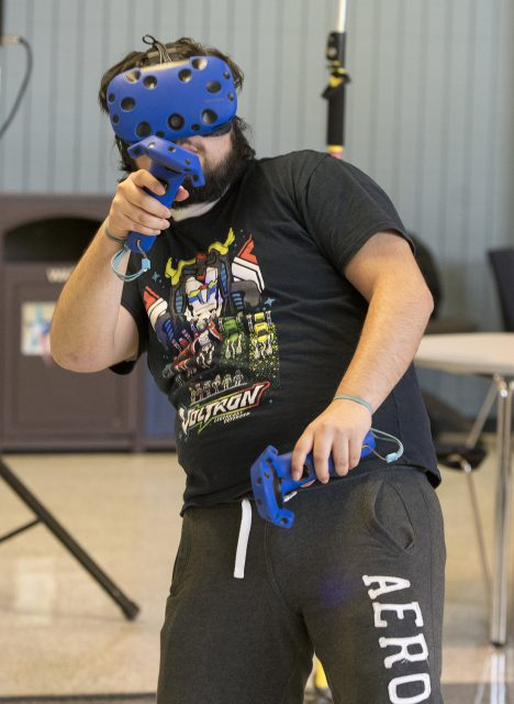 Fort Worth resident Alejandro Zamorano gears up for a fight while playing a Smash Bros. virtual reality game.