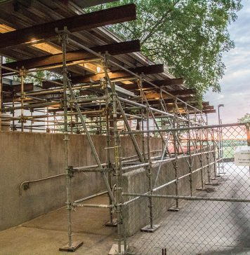 Scaffolding and structures fill the walkways between the WSTU, WTLO and WPHE buildings to protect students from overhead debris.
