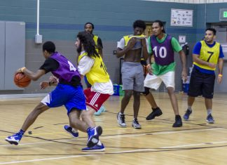SE student and Dope Boys team member Adrian Morales guards a member of TCC Underdogs in the 5-on-5 intramural basketball championship Oct. 19 on SE Campus. The Dope Boys won the game and earned their second championship title.