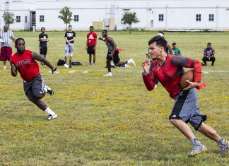 SE student Angel Chapa sprints downfield as opposing team player Giovanni Cesto looks to stop his advancing to the end zone during a SE intramural flag football game Sept. 28.